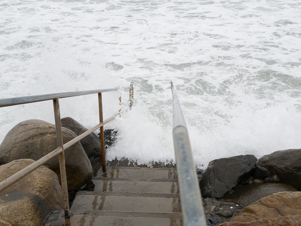 Used to be stairs to the beach, now stairs into the ocean