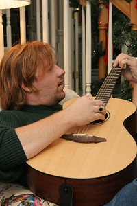 Playing on the acoustic guitar he got in Nashville last Christmas