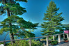 HDR - looking from veranda to Clear Lake<br /> (see the extra detail in the branch in the middle of the picture), and the sky seems overly blue<br /> * sometimes HDRs look more like impressionist paitings