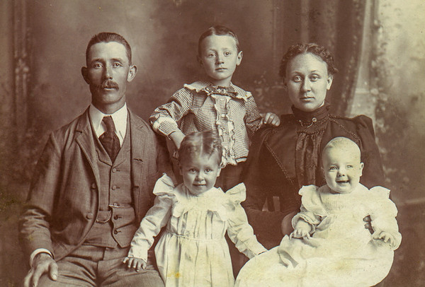 John Jr. and wife Ida Opal with their children; Phillip Amos being the oldest, daughter Edith was the second child, and Eunice was the baby.