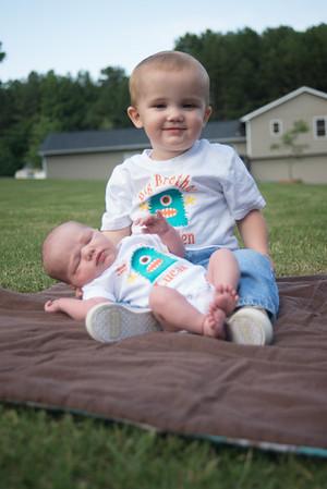 Breyden holding Lucas - Newborn Photos
