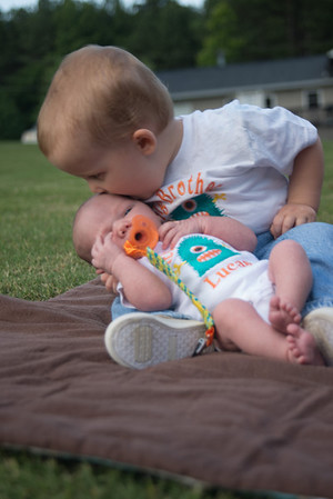 Breyden kissing Lucas - Newborn Photos