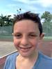 Practicing tennis.