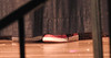 Jack's shoes - under the stage curtain.
