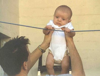 JFT - 9 weeks old - Dad teaching him pull-ups on washing line - 27 10 01 - 13A-01-60
