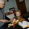 Helping Nana make applesauce .