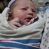 Jack in his first swaddling and first time held by mom, March 7, 2012.