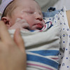 Jack in his first swaddling, and first held by his mother, just a few minutes after birth, March 7, 2012.