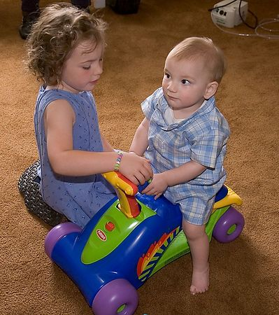 "<br><br><font size=""3"">Big sister helps him check out his new ride.</font>"