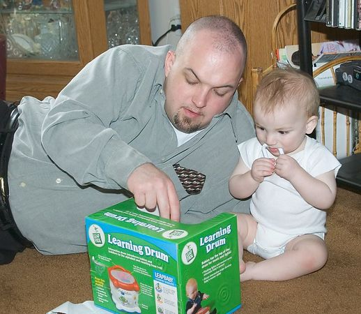 """<br><br><font size=""""3"""">Uncle Eric gives Jacob instruction on the finer points of the Learning Drum.</font>"""