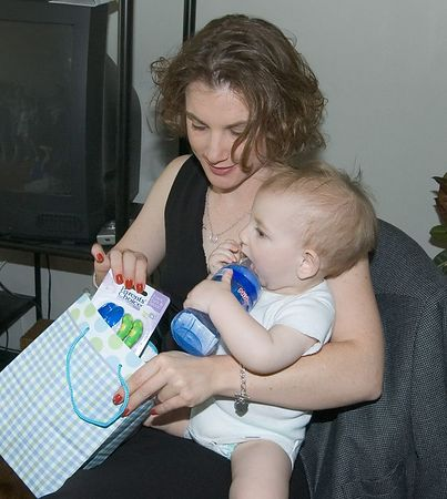"""<br><br><font size=""""3"""">Jacob get's a little help from mom with one of his presents.</font>"""