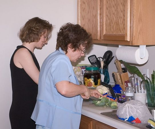 """<br><br><font size=""""3"""">Mom and Grandma work on the treats.</font>"""