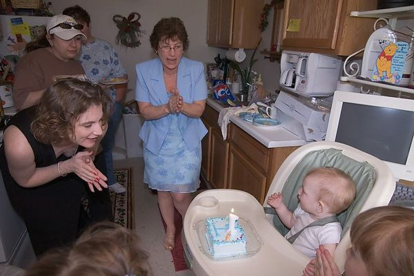 """<br><br><font size=""""3"""">Everyone encourages Jacob to blow out the candle on his cake.  He may not know what to do with a lit candle...</font>"""