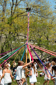 Dancers weaving the May Pole