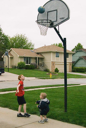 """<font size=""""3"""">The boys wrap up the night with a few baskets.</font>"""