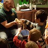 Everyone got a chance to touch many of the reptiles. (And check out the cake in the background!)