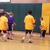 Mason's 2nd/3rd grade basketball team playing a game.