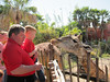 Ken and Spencer feeding a giraffe, Lowery Park Zoo, Tampa, 3/16/2013