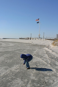 Anisa looking for shells.