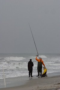 A family trying to get the fish early in the morning.