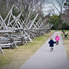 Kiddieboos running past giant Jenga-like fence