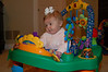 Look at me, I am now big enough to play in my exersaucer!
