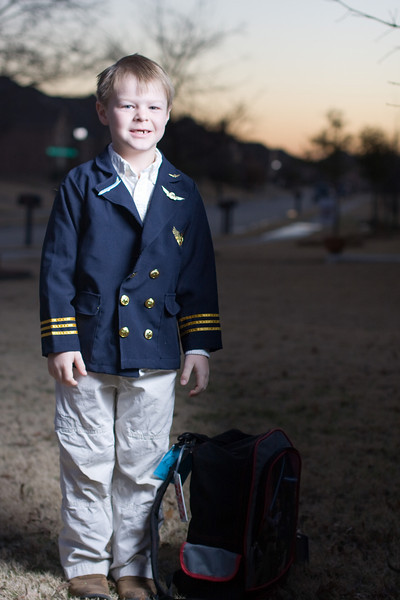 Jeb dresses up as a pilot for Career Day