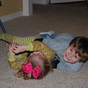 Levi and Camden wrestling on the floor.