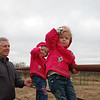The girls watching the horses before getting a chance to feed them.
