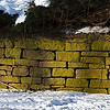 brownstone wall along Mountain Road