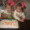 Helping blow out the candles.