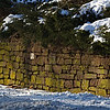 brownstone wall along Mountain Road