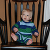 Hmmm... did mommy really let me sit on the rocking chair by myself.