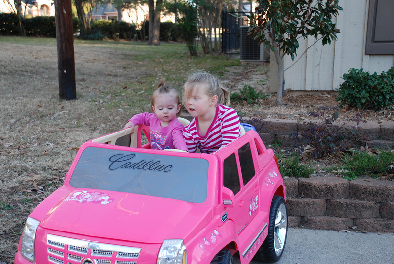 Camden taking Carlyle for a ride in the Caddy.