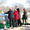 family placing a final rose and saying a final farewell