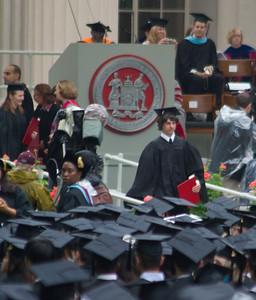 Walking back with his diploma.