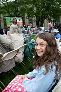 Anisa with the giant TV in the background.  She came prepared with things to read and activities to do.  We staked out the five seats for me, Anisa, Linda, Rich and Christine.