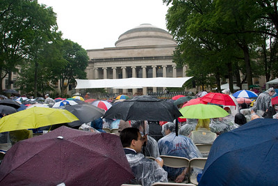 As the rain turned into a downpour, the umbrellas came out.