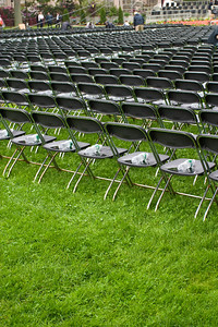 Every chair had a water bottle and a puddle of water on it.