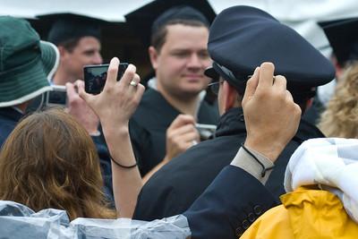 The graduating class enters and more cameras click.