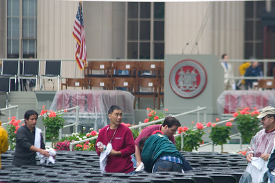The ground crew drying the chairs after the major downpour passed.