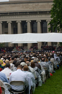 There were plenty of ushers to keep folks from standing around the aisles and blocking the view.  MIT has been having commencement in the court for over fifty years now, come rain or shine.