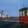 The Astoria Trolley Car stopped in front of the Columbia Maritime Museum.  Columbia Lightship in the background.