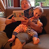Grandma Reading to Cormac While He Peeks at Camera