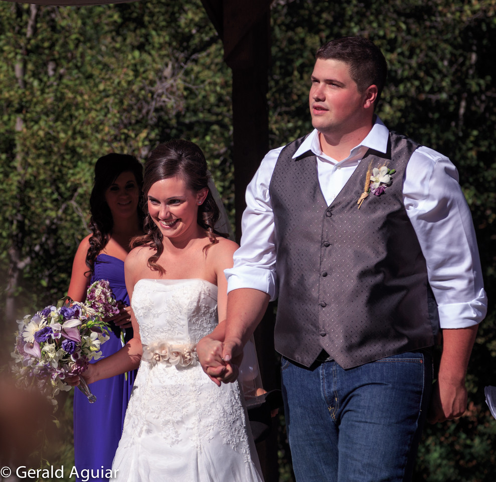 The happy couple leaving the ceremony