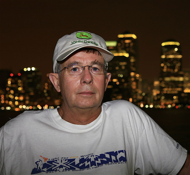 This is a photo of me with the skyline of New York City in the background.   I'm wearing my favorite John Deere hat.