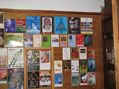 The Ancora concert poster among many other posters