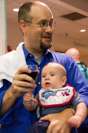 """Joel found my wine glass to be utterly fascinating. Other wedding guests approved that we were """"starting him early""""."""