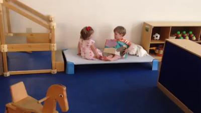 Joel reads to Gigi