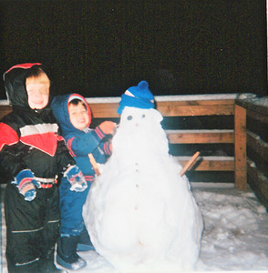 joe and pat with snowman
